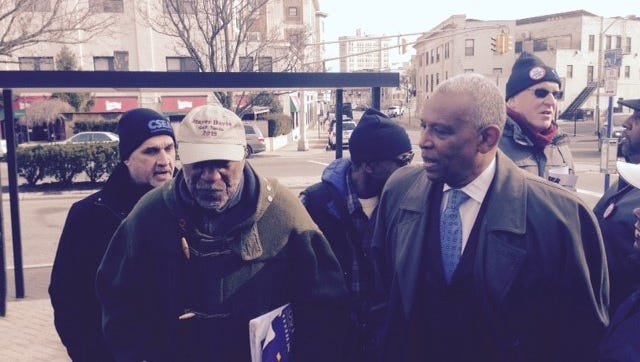Former Mount Vernon mayors Ernie Davis, center left, and Clinton Young, right, address rally opposing recent firings of union members outside City Hall on Jan. 30, 2017. At far left is Nicholas Cicchetti, president of the Mount Vernon unit of CSEA Local 860, who was one of those dismissed.