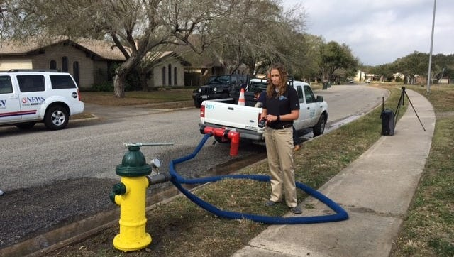 Crystal Ybanez, City of Corpus Christi Utilities Department work coordinator, explains why crews need to flush hydrants every day.