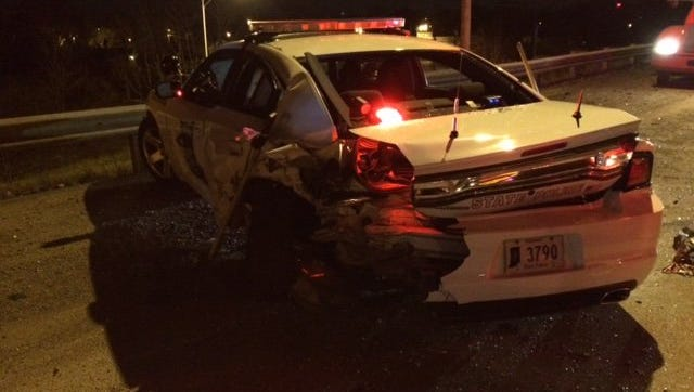 A suspected drunk driver struck an Indiana State Police patrol car early Sunday morning.