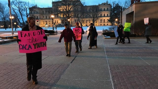Supporters of a resolution to declare Lansing a sanctuary city marched Jan. 30 outside Lansing City Hall. Several were members of the group BAMN -- By Any Means Necessary. An organizer for the group said last month they will continue to attend City Council meetings.