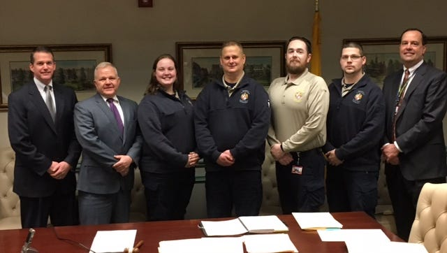 From left, Morris County Communications Center Director Mike Peoples, Freeholder Director Doug Cabana, Public Safety Telecommunicators Ashley Napolitano, Kirk Keyes, William O'Connor, and Fred Sharp, and Morris County Director of the Department of Law and Public Safety Scott DiGiralomo.
