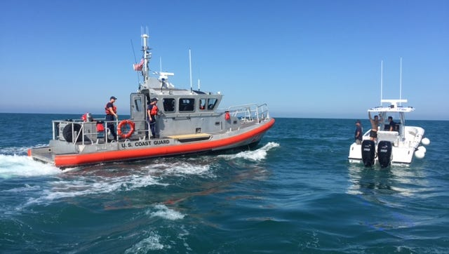 Coast Guard and Collier Sheriff's Office boats arrive on the scene to assist on Saturday, Feb. 4. The Casabona family helped rescue five people, including three children, from a capsized boat 12 miles west of Gordon Pass.