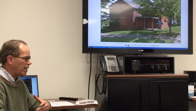 Scott Schaut, curator of the Mansfield Memorial Museum, talked to members of the Richland County Land Bank about their interest in acquiring a historic house at First and Wood streets on Wednesday. The board made a motion to acquire the house.
