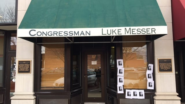 Ten posters apparently urging U.S. Rep. Luke Messer to take his own life were placed outside his Muncie congressional office on Tuesday.