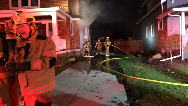 Fire Chief Steve Ott and firefighters on the scene of a house fire on Ann Arbor Trail.