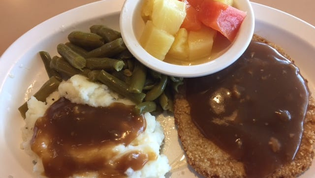 One offering at Tracy's Restaurant is the breaded veal steak with mashed potatoes, brown gravy, green beans, a fruit cup and a roll.
