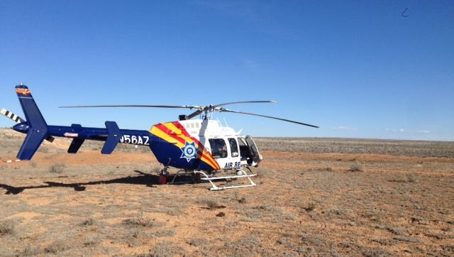 Arizona Department of Public Safety officials rescue a Texas woman from a remote area near the Grand Canyon after she was stranded for five days on March 17, 2017.