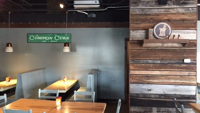 The Common Cure Bar & Grill will open at 15 Conestee Ave., March 28.