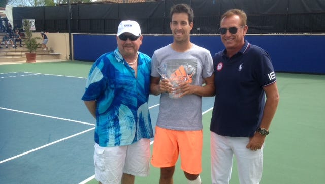 Sebastian Fanselow (center) poses with Jeff Richards and Steve McAvoy after winning the USTA Men's Pro Tennis Championships of Calabasas on Sunday.