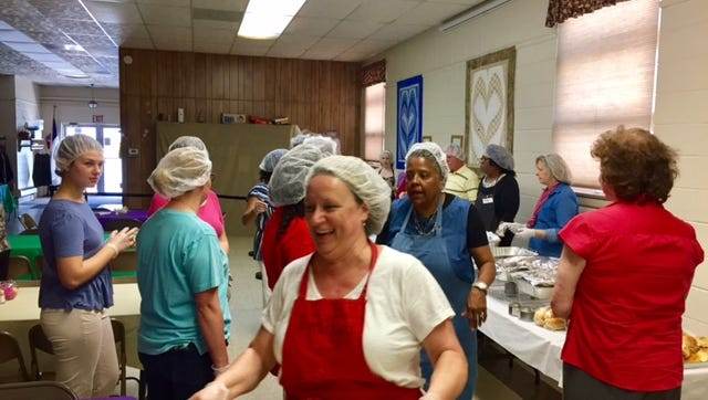 Volunteers provided companionship and food for homeless guest during an Easter Sunday meal at Bethany Grace Community Church.