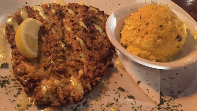 Pistachio-crusted trout, with a side of cheesy grits, was a recent nightly special at Sullivan's Fine Foods in Rocky Hill.