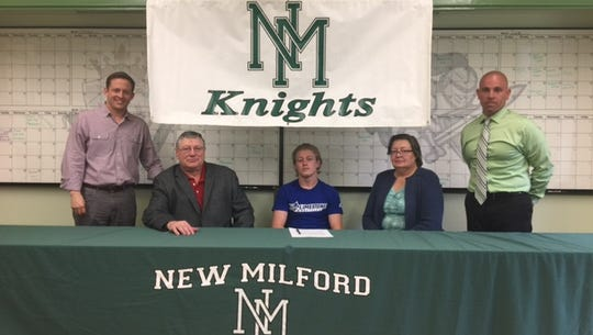 John Burger of New Milford HS signs his letter of intent