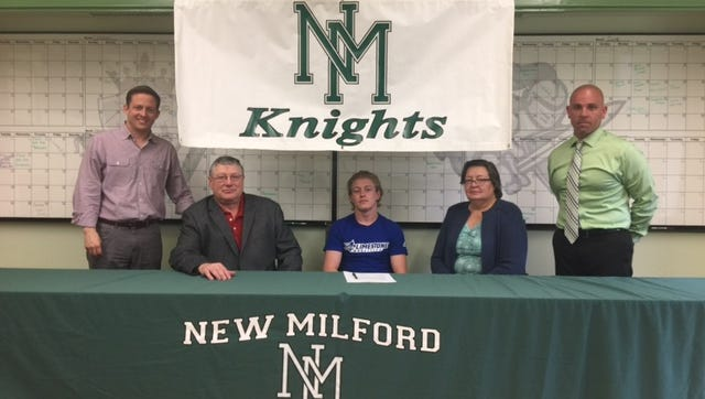 John Burger of New Milford HS signs his letter of intent to attend Limestone University in South Carolina
