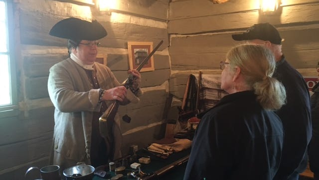 Jack Johnson portrays a Virginia militia member and shows visitors to the Blockhouse Saturday in South Park tools used by the militia from guns to knives and compasses.