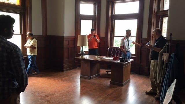 A school group tours the Shawshank warden's office.