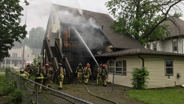 Firefighters battle an apartment fire on Battle Creek's north side