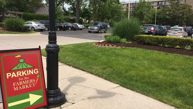 Farmers Market parking has expanded to the Village Commons Mall, east of the market on Grand River.