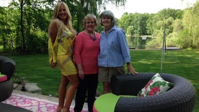 Avid gardener Laurie   Fischgrund with Cynthia Ammon and Margaret Bancroft, co-chairpersons of the Franklin Garden Walk, discuss details for the June 14th Garden Walk. They are standing on one of the beautiful decks built by Jeff Fischgrund.