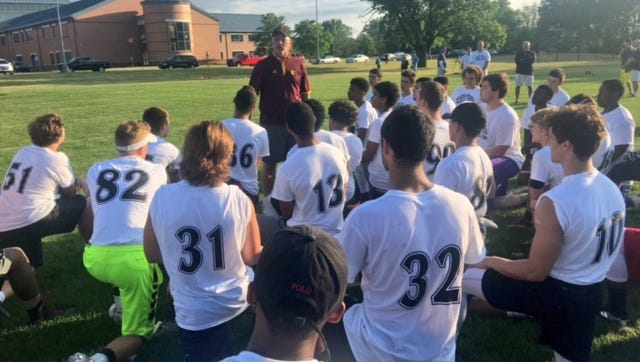 Campers receive instruction during the Okemos 'Best of Best Football Camp' last year.