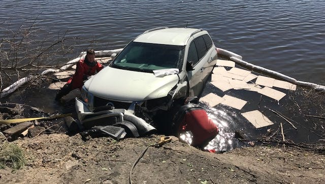 Loveland Fire Rescue Authority crews work to remove a Nissan Pathfinder from Lake Loveland Wednesday morning.