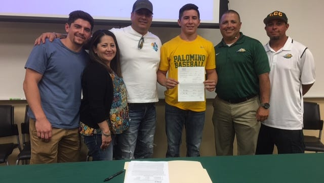 T-M grad Nick Galaviz, second from left, signed with St. Mary's University on Thursday.