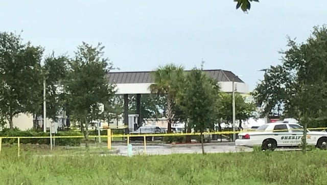 Crime scene tape blocks off access to the 7-Eleven store at Sunshine and Lee boulevards in Lehigh Acres after a shooting was reported there Monday afternoon.
