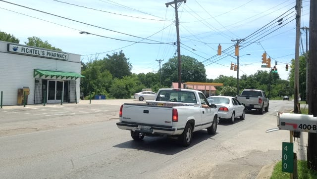 Drivers wait at a light along Old Nashville Highway. La Vergne Mayor Dennis Waldron said his city is working on plans to widen the two-lane highway to three or five lanes.