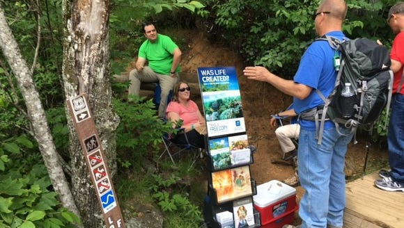 Hikers come across a religious group handing out pamphlets