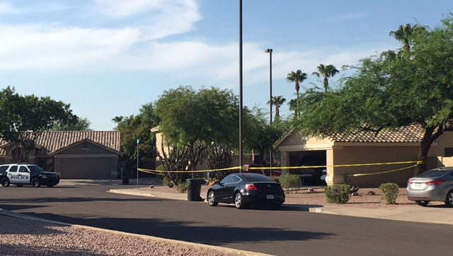 Crime-scene tape rings around a home where a woman was shot dead in Mesa on July 13, 2017. Police believe the shooting was domestic-violence related and have arrested a suspect.