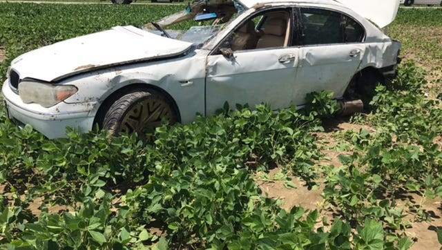 A rural Mooreland man was killed Friday when his car left Wilbur Wright Road and rolled several times in a bean field