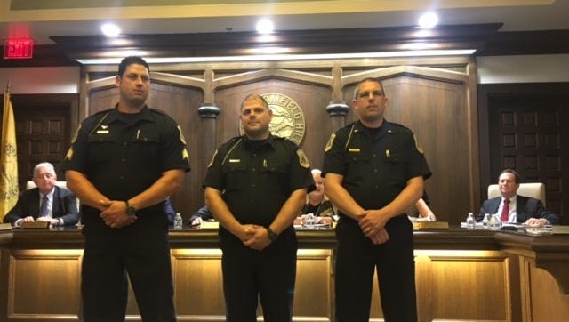 Police Sgt. Daniel Phillips (left), Lt. Dustin Lockard and Det. Lt. Jeff Gormley at the June 11 Bloomfield Hills City Commission meeting.
