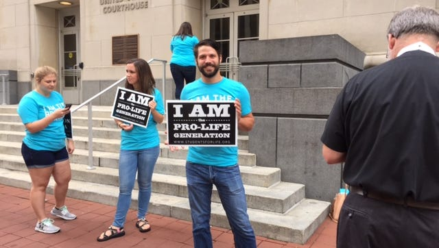 Anti-abortion protesters gathered outside the Sixth Circuit Court of Appeals in Cincinnati prior to oral argument on Tennessee abortion measure Amendment 1.