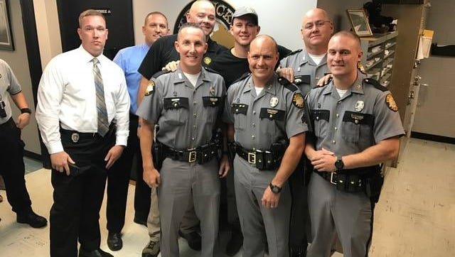 Channing Tatum meets with Kentucky State Police troopers in Harlan, Kentucky, on Monday.