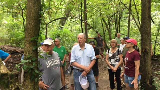 Mariemont may outlaw bikes on the Whiskey Run Creek trail that connects Dogwood Park and the South 80 Gardens and Walking Trails Park. Here are people on a village-sponsored tour of the area on July 23, 2017.