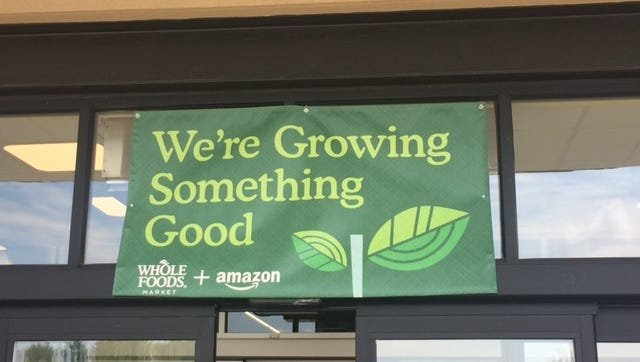 Banner seen over the Nora Whole Foods.