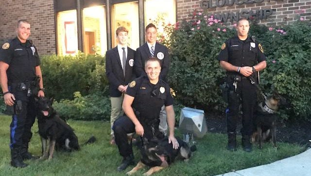 St. Augustine Prep students Devon Osgood (left rear) and Michael Rebbecchi (right rear) are shown with Gloucester Township police officers and their K-9 partners. The pair presented the department with three protective bullet proof vests for the three K-9s. The pair created a community project called Operation K-9 Kevlar and raised funds from the community through there. The police officers and canines pictured are (left to right): Michael Przeworski ( K-9 Sarge); Joe Eden (K-9 Cody) and Joseph Thomson (K-9 Nico).