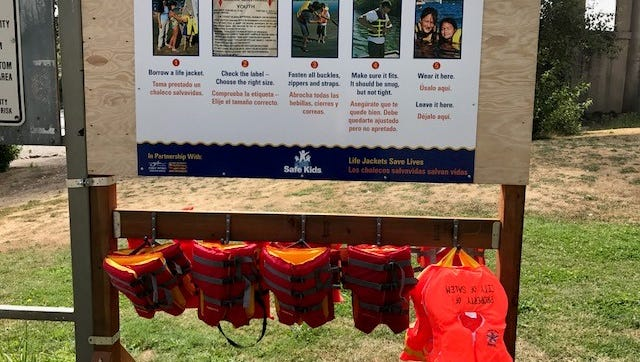 A temporary life jacket station at Wallace Marine Park in Salem.