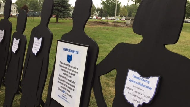Silhouettes representing the 18 people who died from overdoses in Ottawa County since 2015 were set up on the courthouse lawn for Overdose Awareness Day.