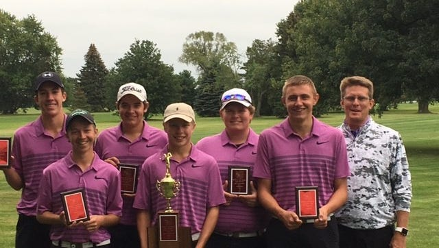 Westbrook Country Club golf pro Greg Smith and his Lexington Minutemen, shown after winning a tournament over Labor Day weekend, won Thursday's Ohio Cardinal Conference tournament and earned a share of the overall OCC title with Wooster.