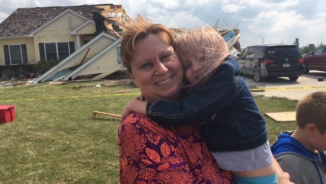 Susan Cooper and her daughter Alyse escaped injury after they were thrown from a bedroom into the backyard after Sept. 4's storm hit their house at 5511 Hook Road. ripping the roof off the bedroom.
