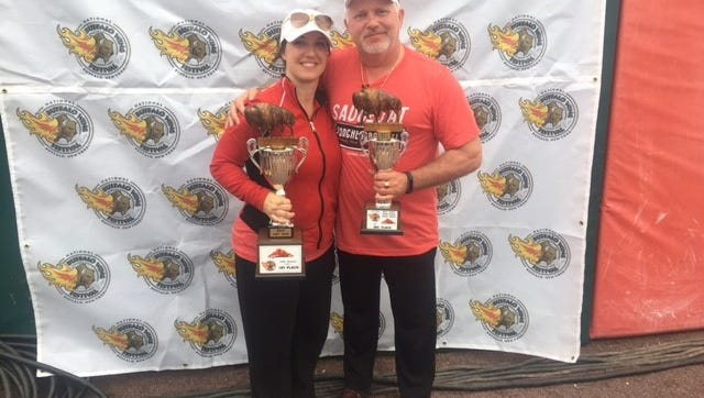 Kim and Bob Yacone celebrate their wins at the 17th Annual Buffalo Chicken Wing Championship in Buffalo, New York.