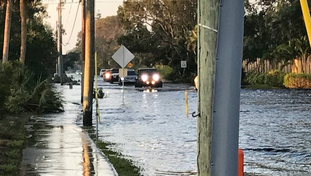 Vehicles going into and out of communities along Island Park Road had to deal with one to two-feet of water remaining on the road on Thursday.