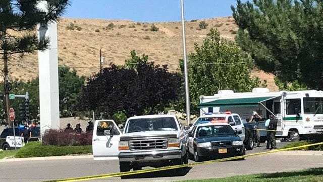 Officers from various law enforcement agencies gather in the parking lot of the Citizens Bank location on Hudson Street in Farmington Aug. 27 after the shooting of a State Police officer.