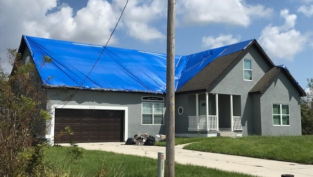 Blue-taped roofs dotted homes around Lehigh Acres in the wake of Hurricane Irma.