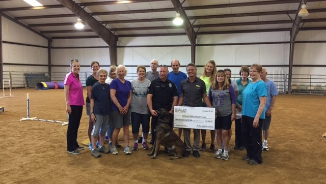 Blue Heron Agility Dogs of Delaware donated $1,000 to the Delmar Police Department for the purchase of a protective vest for K-9 Atilla.