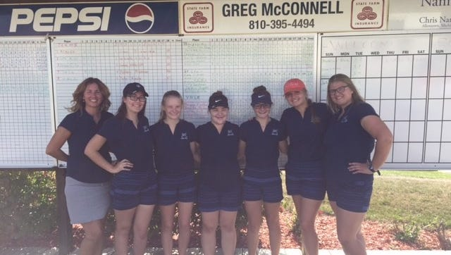 Members of the Marysville golf team pose for a photo after winning the county golf meet.