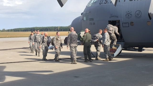 Col. James Camp, commander of the 179th Airlift Wing of the Ohio Air National Guard, along with others, shakes the hands of airmen headed to Puerto Rico to provide meals for military and first responders assisting with relief aid.