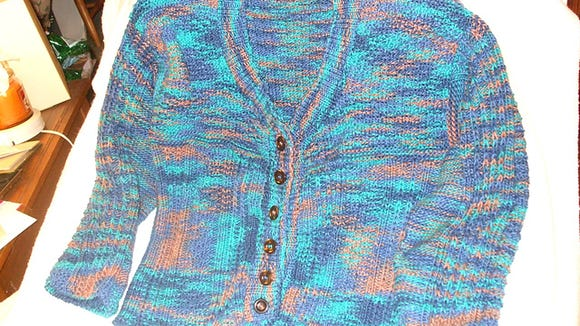 For a long time, I hardly ever wore this sweater, made of Plymouth Yarn's Fantasy yarn, because I was so heavy, it hung short on me. Now that I have lost weight, It fits much better and I've been wearing it almost every day this autumn.