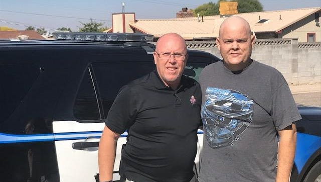 Cedar City employee Troy Goulding poses with Cedar City Police Sgt. Jerry Womack. CCPD is growing out their facial hair as part of a fundraiser to benefit Goulding, who was recently diagnosed with leukemia.