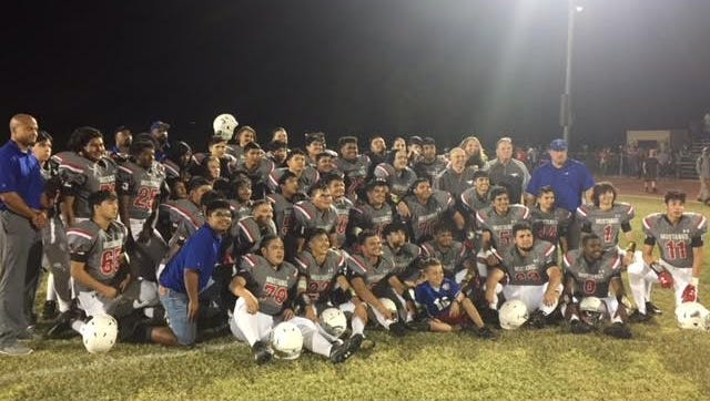 The North High School football team celebrates after a 46-0 win over Maryvale on Oct. 27, 2017.